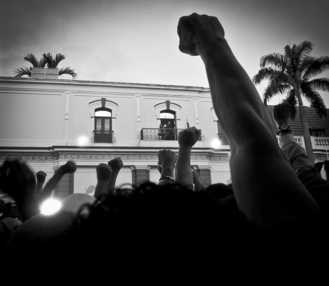 Chavistas raise their fists in support of the revolution during a speech by President Hugo Chávez at Miraflores Presidential Palace in Caracas, after the President return from Cuba, 4 th July 2011. Days before Chávez announced on national television that he had cancer and he returned because on the following day Venezuela celebrated it's 200 th anniversary of independence from Spain.