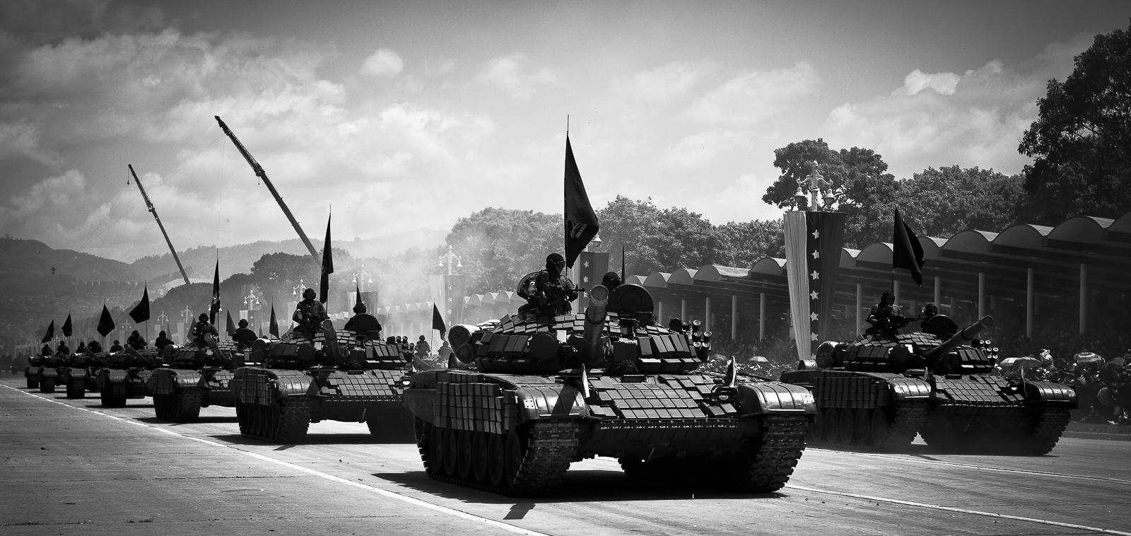 Military tanks parade at Los Proceres Boulevard in Caracas during the celebration of the 200 th anniversary of independence from Spain, 5 th July 2011. President Hugo Chávez missed the celebrations after announcing days before that he had cancer. Venezuela society has become more militarized since Hugo Chávez, a Paratrooper Commander, took office in 1999.