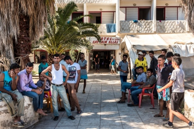 KOS, GREECE — AUGUST 20, 2015: The abandoned Captain Elias Hotel has transformed into a refugee living space in Kos Town. It is primarily composed of single men and families hailing from Pakistan, Irak, and Afghanistan.