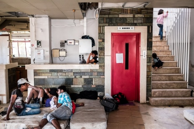 KOS, GREECE — AUGUST 20, 2015: The abandoned Captain Elias Hotel has been transformed into a refugee living space in Kos Town. It is primarily composed of single men and families hailing from Pakistan, Irak, and Afghanistan.