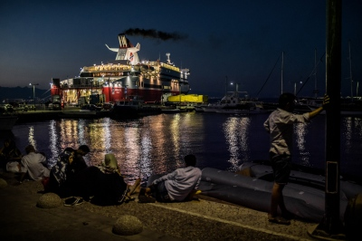 KOS, GREECE — AUGUST 20, 2015: A ferry embarks before its overnight trip to Piraeus, near Athens.