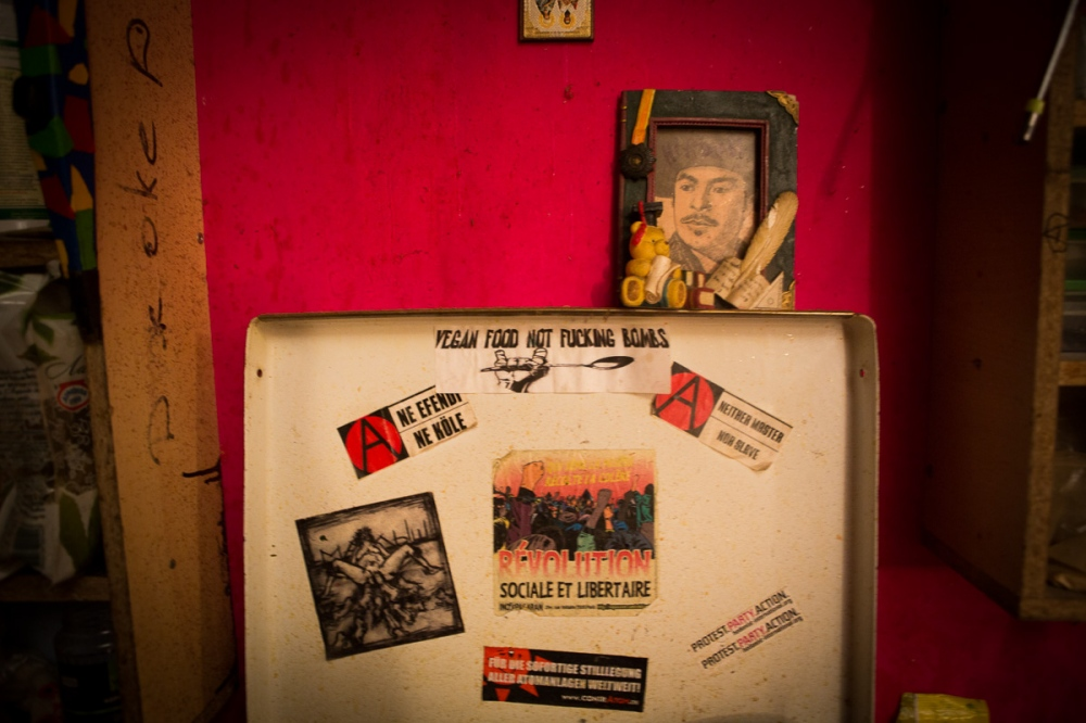 A kitchen oven displays various anarchy bumber stickers in a communal living space in St. Petersburg, Russia.