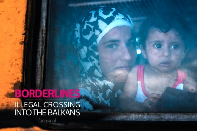 GEVGELIJA, MACEDONIA — AUGUST 25, 2015: A young woman and a child are about to embark on a journey by train to the Macedonia/Serbia border. Lately, many refugees have preferred the 'Balkans route' to make their way into the EU. Up to 3,000 are estimated to be crossing the border every day.