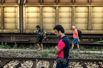TABANOVTSE, MACEDONIA — AUGUST 25, 2015: Three men approach the train station of Tabanovtse, which is the last stop before the Serbian border.