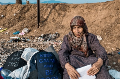 IDOMENI, GREECE — AUGUST 26, 2015: Fatema comes from Aleppo, Syria. She is waiting for some family members, who were left a few hundred meters behind, before entering Macedonia.