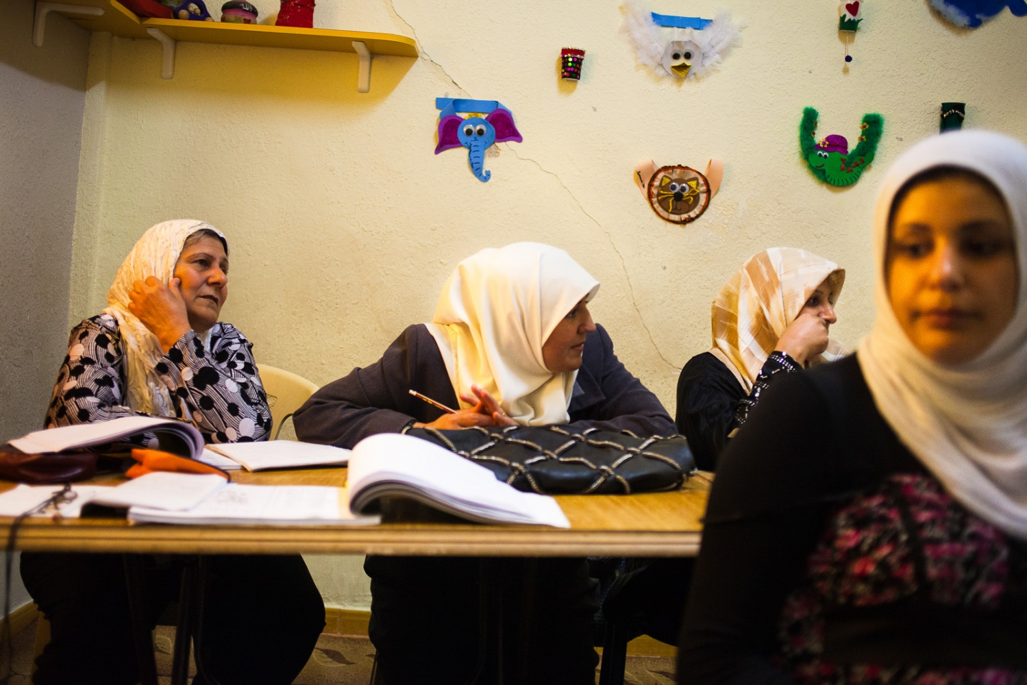Iraqi women attend literacy courses for refugees at the UNICEF women's center in the Hashmi Shmali neighborhood of Amman. The center provides childcare so that women can come to learn new skills, socialize with other women and have a break from their kids.