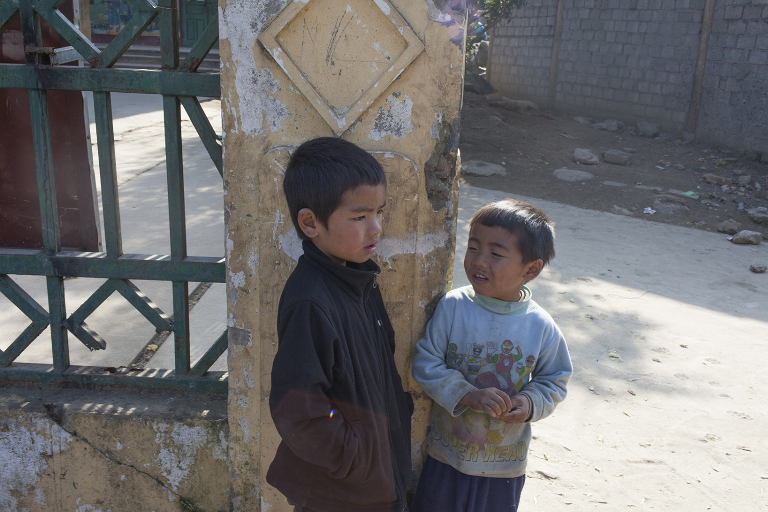 Kids debating important matters in the street in a village.