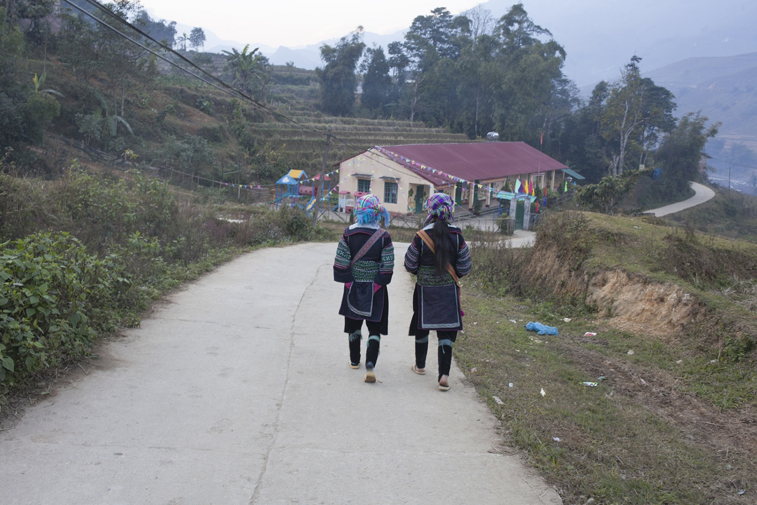 Ling and her friend walking in their traditional dress.