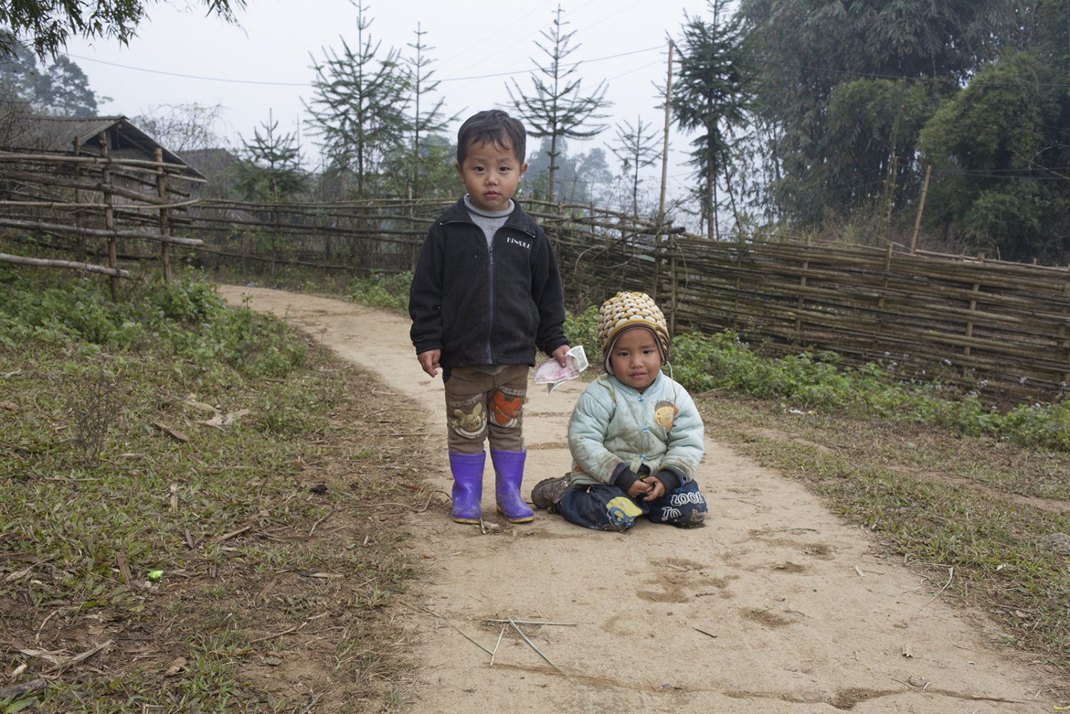 Two Hmong boys playing with «fake» money.