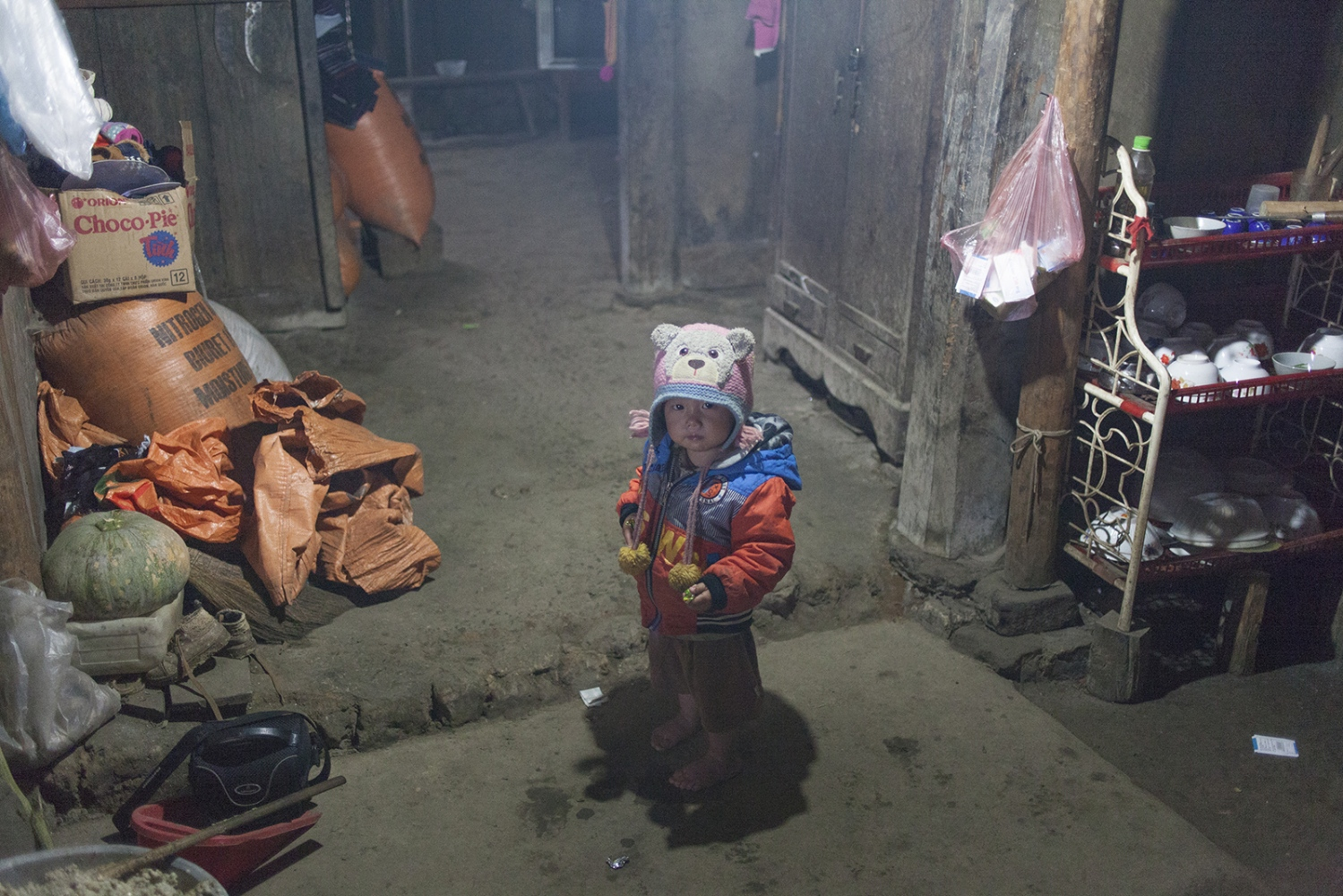 Kid in a traditional house.