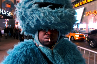 New York, UNITED STATES ,Afro American dressed up as Cookie Monster ask for donations after posing for pictures in Times Square.