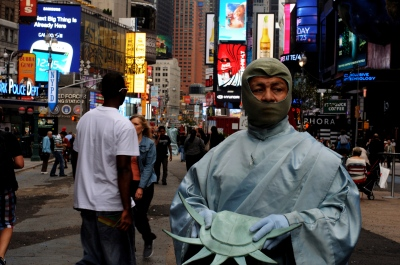 Colombian immigrant works as the Statue of Liberty to send money back to his family. Times Square.
