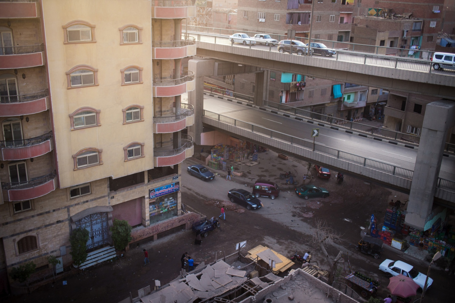 p.p1 {margin: 0.0px 0.0px 0.0px 0.0px; font: 10.0px 'Lucida Grande'} The Saft el Laban area of Cairo is seen from atop an apartment building. Ten years ago, this area consisted of farmland and single-family homes. The area is bisected by a busy highway overpass, and in response to rapid population growth and the high cost to buy new land, residents began building towering concrete apartment blocks in a frenzied, unplanned development. Mish Madrasa is a grassroots volunteer group that provides tutoring and after school activities to poor children in Saft el Laban, a slum neighborhood of Cairo.