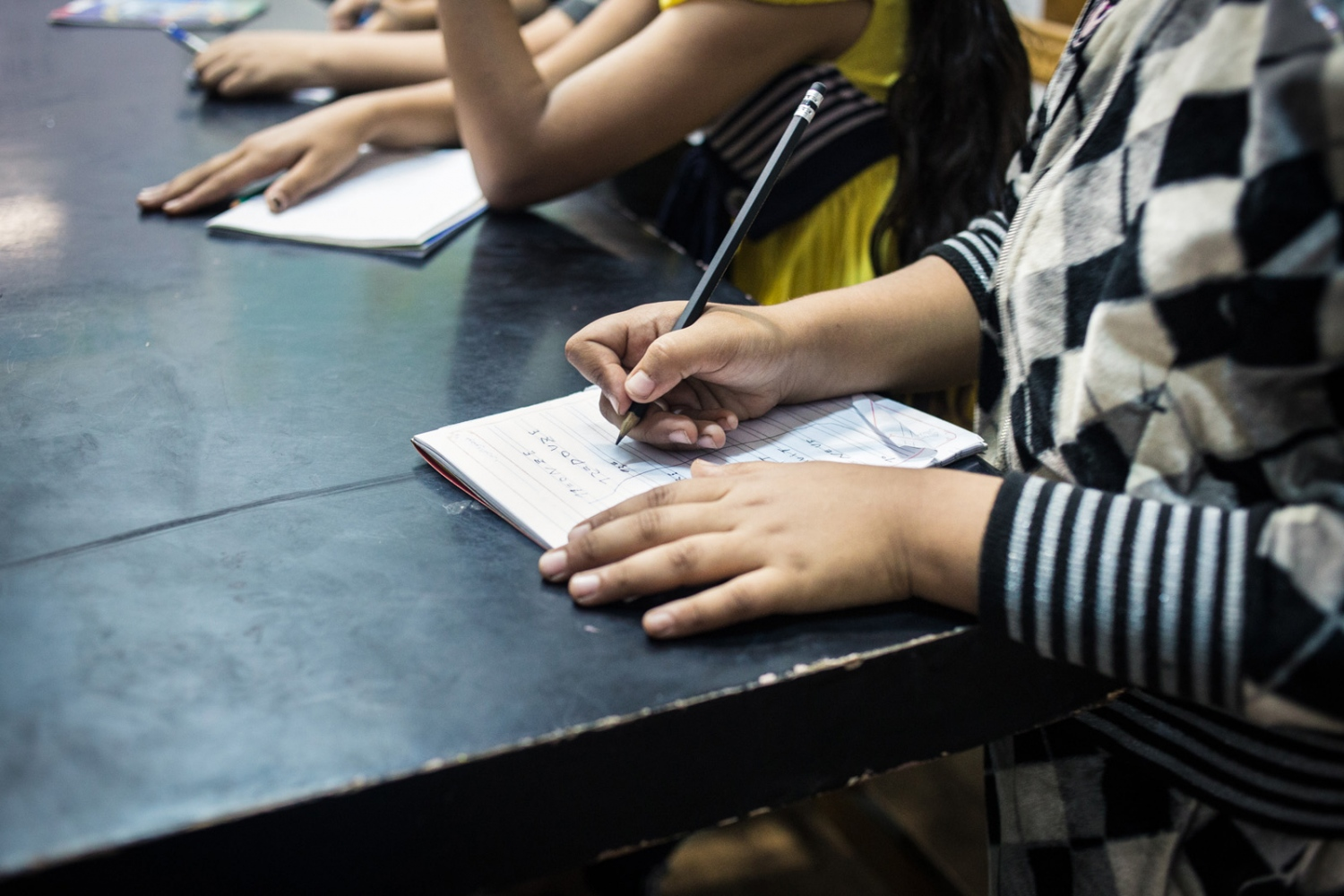 p.p1 {margin: 0.0px 0.0px 0.0px 0.0px; font: 10.0px 'Lucida Grande'} Noura copies down French numbers in her notebook during French class. Mish Madrasa is a grassroots volunteer group that provides tutoring and after school activities to poor children in Saft el Laban, a slum neighborhood of Cairo.