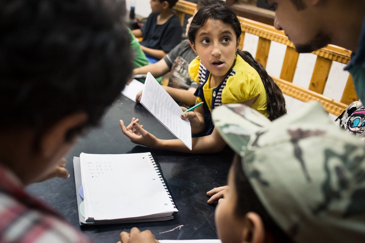 p.p1 {margin: 0.0px 0.0px 0.0px 0.0px; font: 10.0px 'Lucida Grande'} Fatma asks Mostafa to check her work in her notebook during French class. Mish Madrasa is a grassroots volunteer group that provides tutoring and after school activities to poor children in Saft el Laban, a slum neighborhood of Cairo.