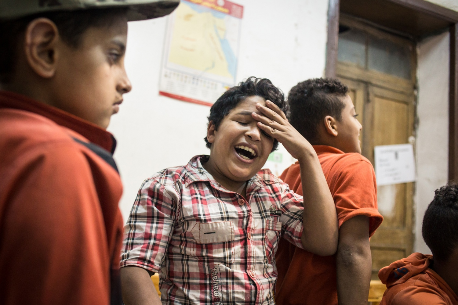 p.p1 {margin: 0.0px 0.0px 0.0px 0.0px; font: 10.0px 'Lucida Grande'} Students reacting after guessing the wrong number during a game in French class. Mish Madrasa is a grassroots volunteer group that provides tutoring and after school activities to poor children in Saft el Laban, a slum neighborhood of Cairo.