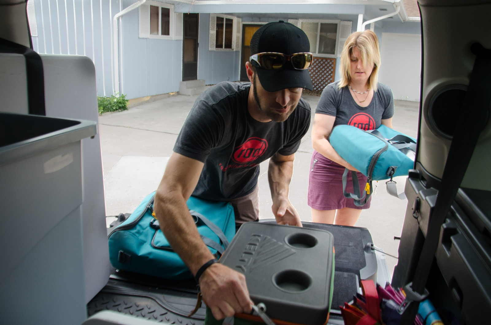 Kelly and Morgan load up the truck.  While they deliver by bike whenever possible, they are preparing to serve a party of 15 for Ironman Dave Scott's Ironman Training Camp.