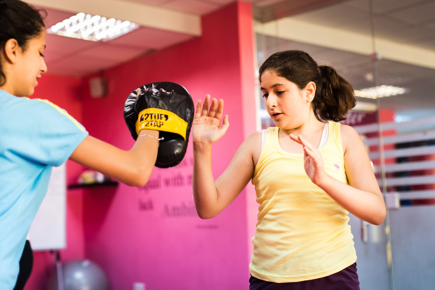 Reem Habib and Sana Kayyali practice different punching and kicking techniques in a self defense course at She Fighter in Amman, Jordan, on August 21, 2015. The She Fighter studio was founded by Lina Khalifeh, and offers self defense classes to young women to protect against harrassment.