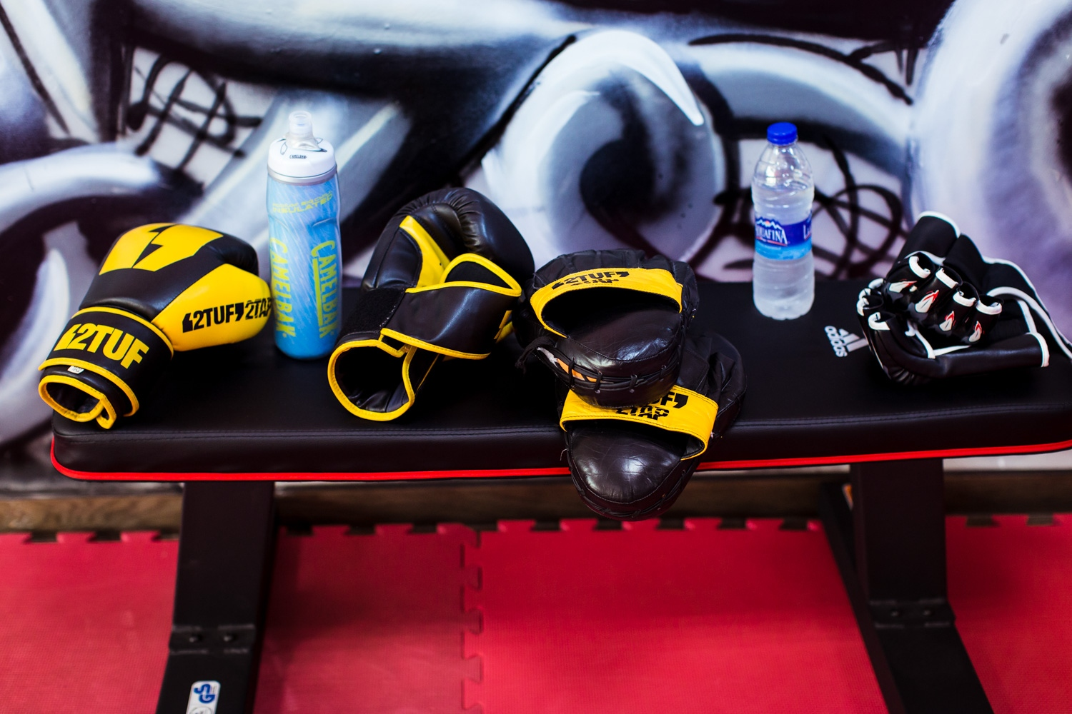 Gloves and other training equipment are seen in a training room at She Fighter in Amman, Jordan, on August 21, 2015.