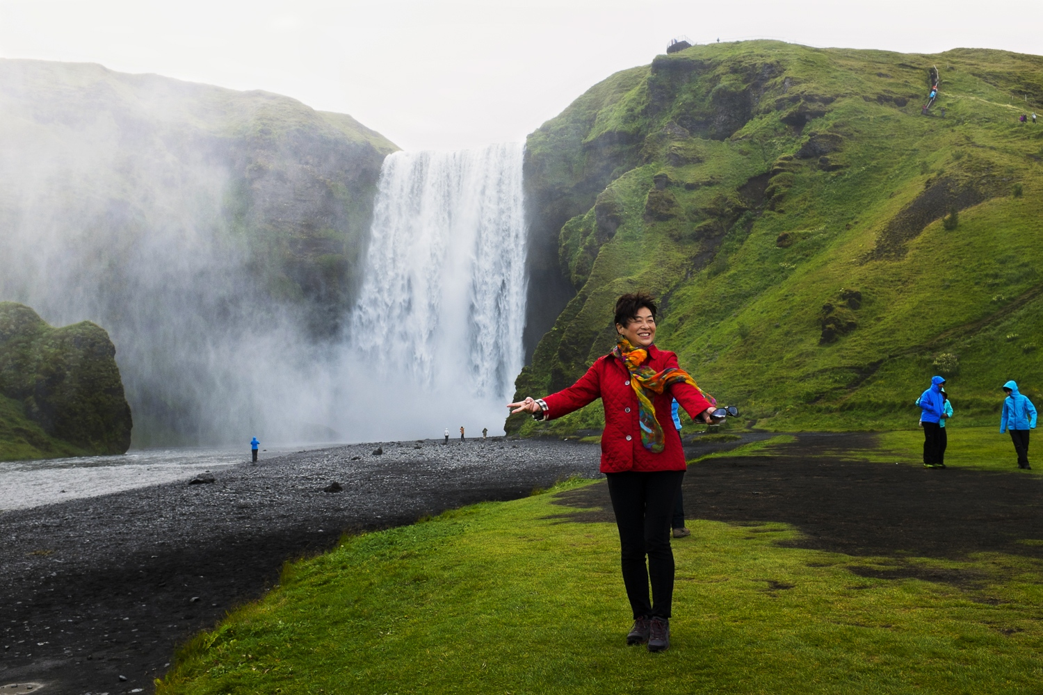 A Chinese tourist at Skógarfoss.