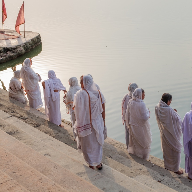 6 Sep 2014 - Vrindavan, India - A group of widows perform a prayer on the ghats of the Yamuna river in the holy town of Vrindavan, Uttar Pradesh. Some 20,000 widows have made the journey to Vrindavan as many of them have been kicked out of their homes, shunned by society, and have nowhere else to go.