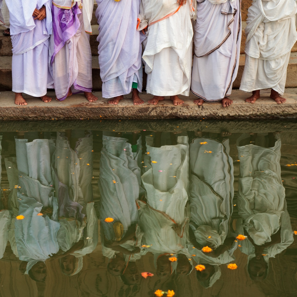 6 Sep 2014 - Vrindavan, India - A group of widows pray on the ghats of the Yamuna river in the holy town of Vrindavan, Uttar Pradesh. Some 20,000 widows have made the journey to Vrindavan as many of them have been kicked out of their homes, shunned by society, and have nowhere else to go.