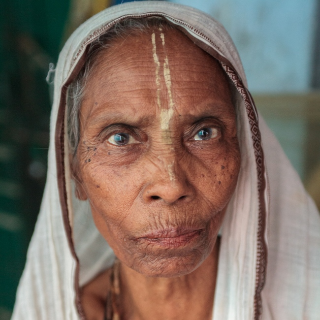 7 Sep 2014 – Vrindavan, India - Mayarani Dasi, 80 sits for a portrait at the Meera Sahabhagini Ashram, a home for over two hundred widowed women from West Bengal. Mayarani has made her home at the ashram for nine years and feels at peace there.