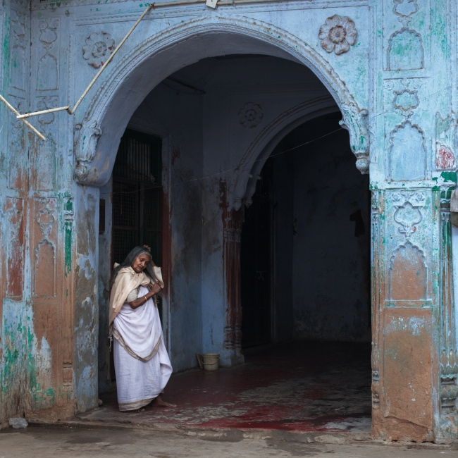 8 Feb 2015 - Vrindavan, India - A widowed woman in the Meera Sahabhagini ashram for widowed woman combs her hair and passes the time.