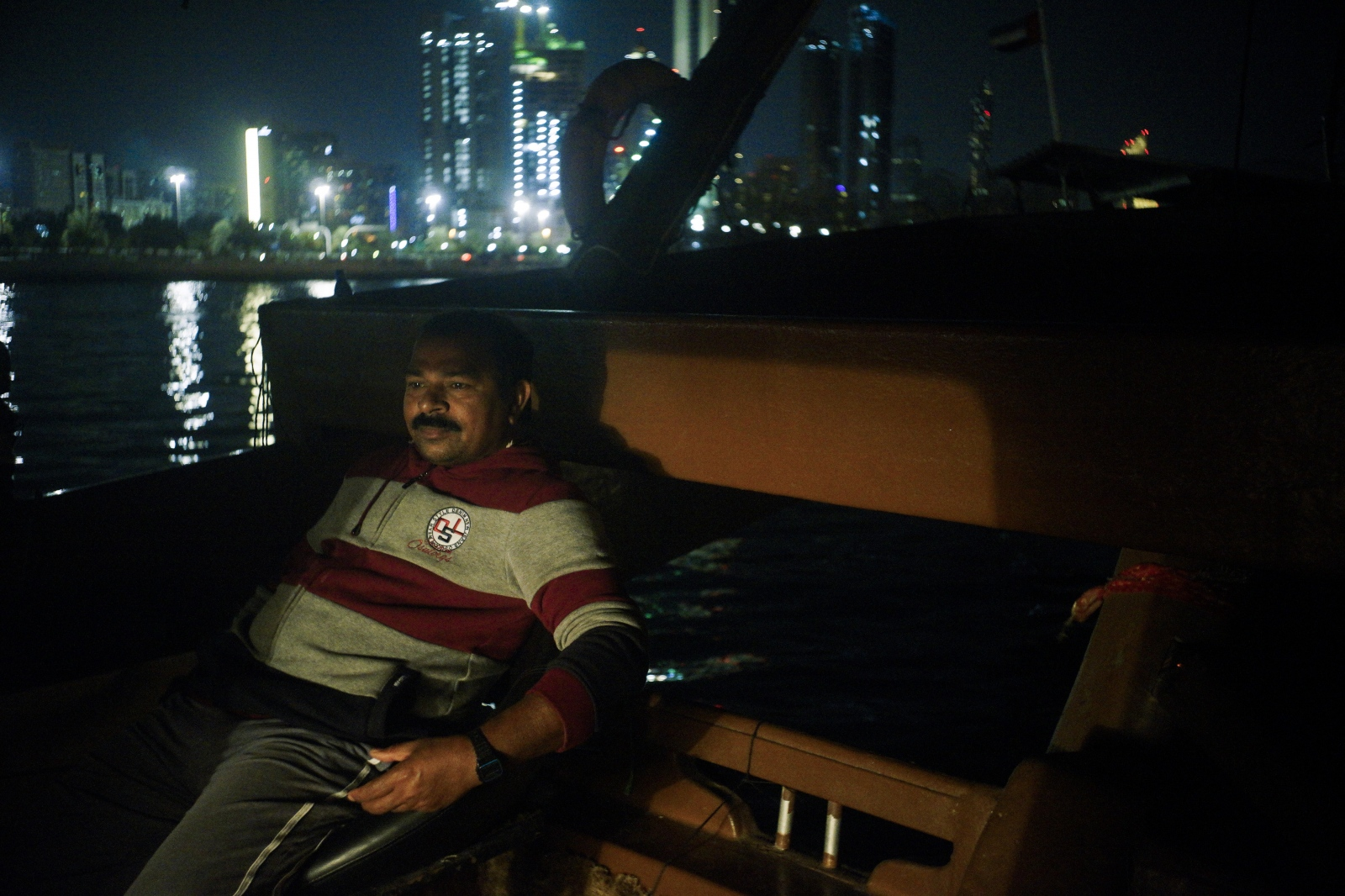 Eddy Krishna is the captain of this wooden trawler, but an Emirati owns the boat. The owner claims half of what the five fishermen catch out at sea. Rising operational and equipment costs worry Eddy Krishna.