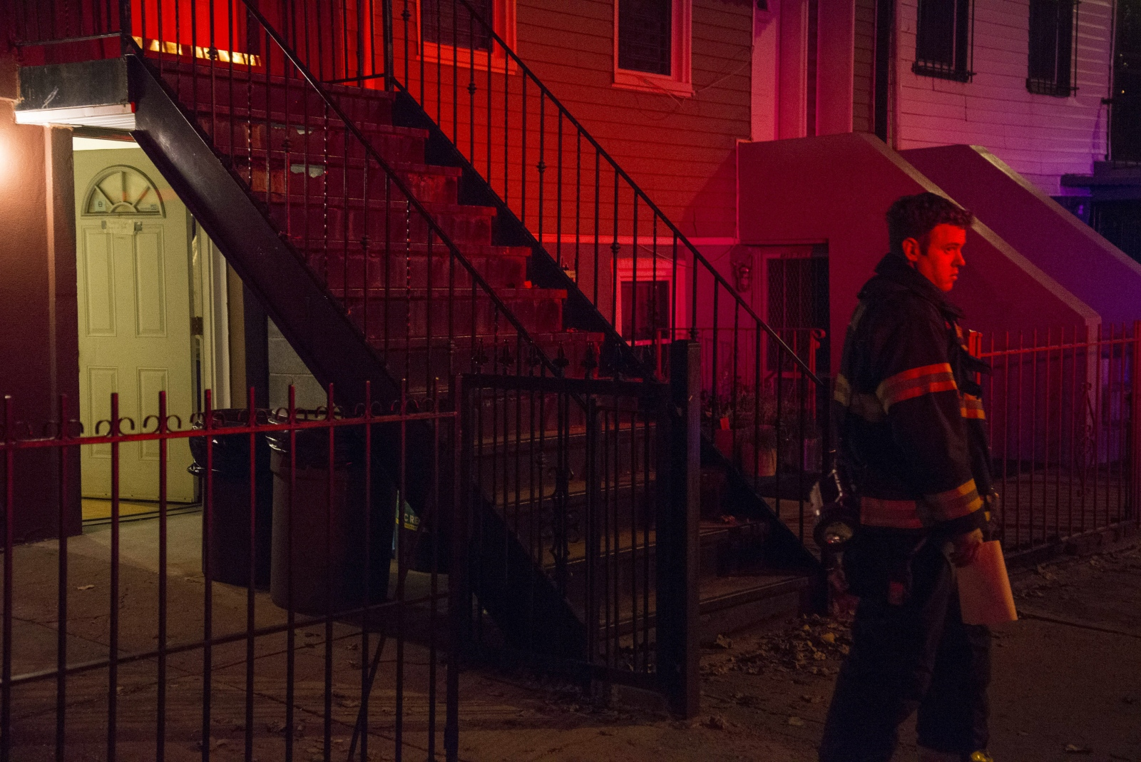 Lieutenant McDonald leaves the house of a 102-year-old woman to usher the medical unit inside.