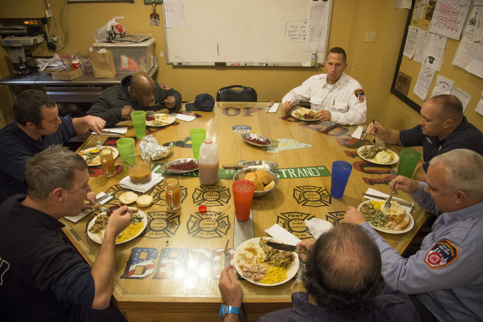 Firefighters of firehouse 235 eat Thanksgiving dinner while on the job. Firefighter Colabella comments he doesn't mind working Thanksgiving shifts because he knows he will be with the best of men.