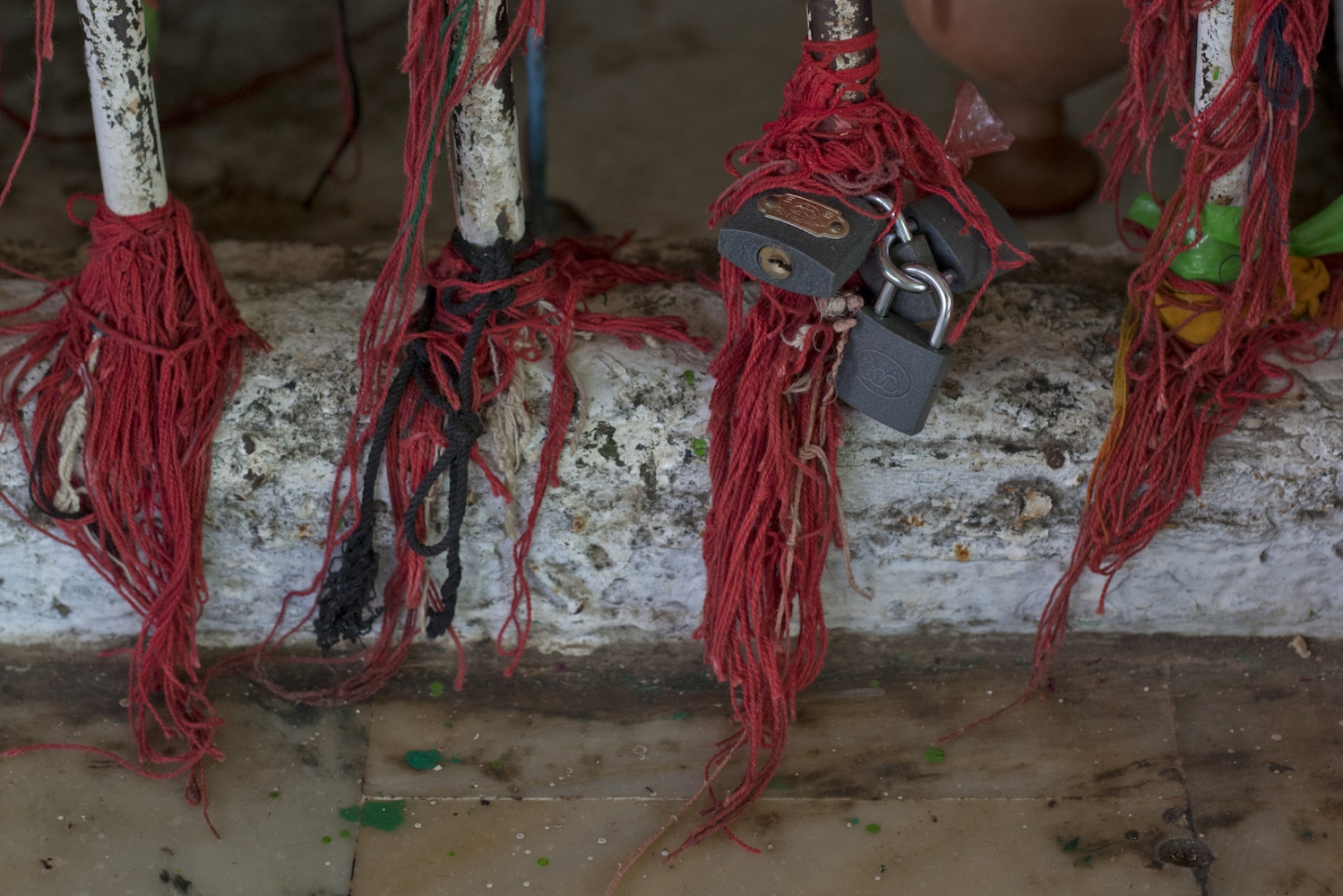 Padlocks and threads symbolising the prayers of Pakistani worshippers are left at the tomb of spiritual leader Hazrat Abdullah Shah Ashabi in Makli in the district of Thatta in Pakistan's Sindh province on November 24, 2011.