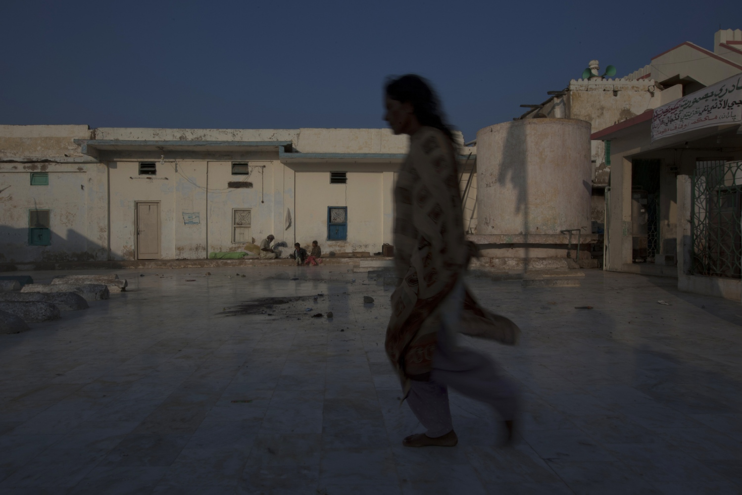 A Pakistani resident believed to be possessed by a demon paces inside the shrine of spiritual leader Hazrat Abdullah Shah Ashabi in Makli in the district of Thatta in Pakistan's Sindh province on November 25, 2011.