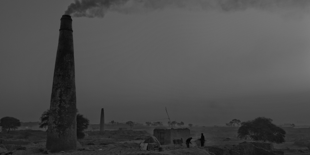 Pakistani labourers work at a brick factory on the outskirts of Islamabad on January 11, 2012.
