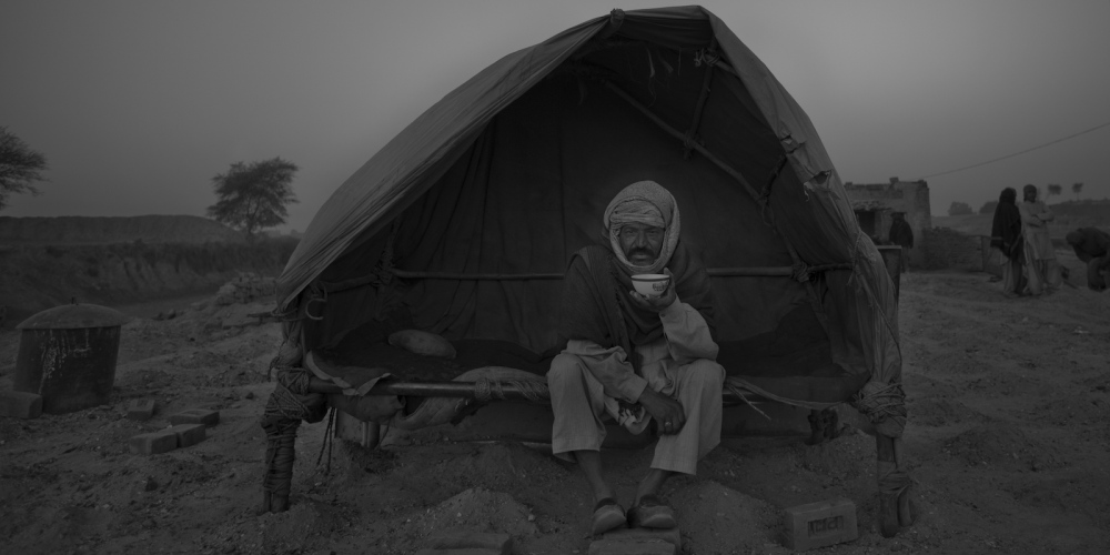 A Pakistani labourer drinks tea for breakfast at a brick factory on the outskirts of Islamabad on January 11, 2012.