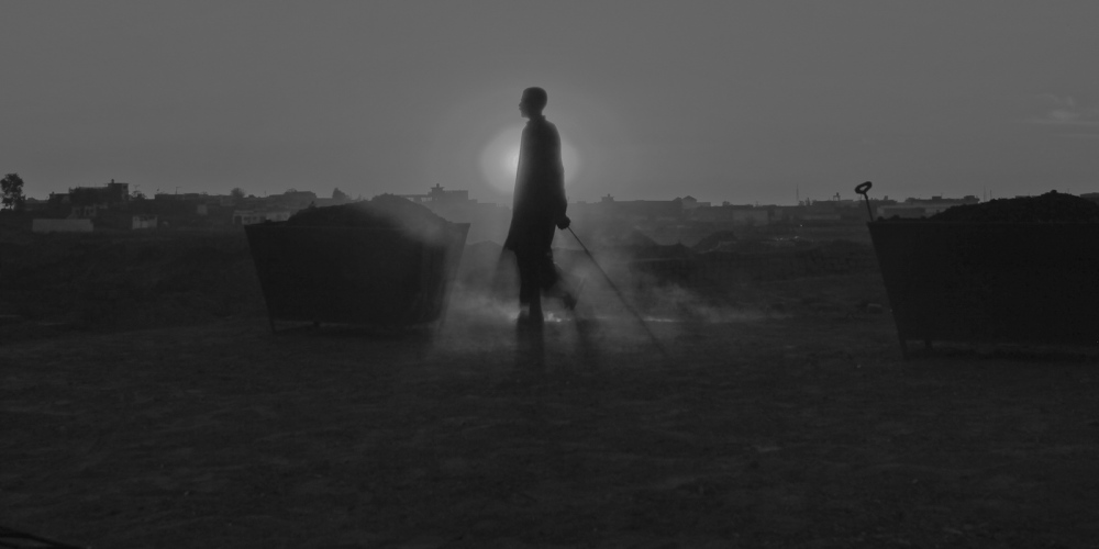 A Pakistani labourer is silhouetted as he walks across the top of a kiln at a brick factory on the outskirts of Rawalpindi on November 12, 2011.