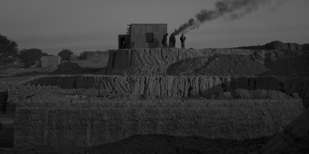 Pakistani labourers prepare to start work at a brick factory on the outskirts of Islamabad on January 11, 2012.