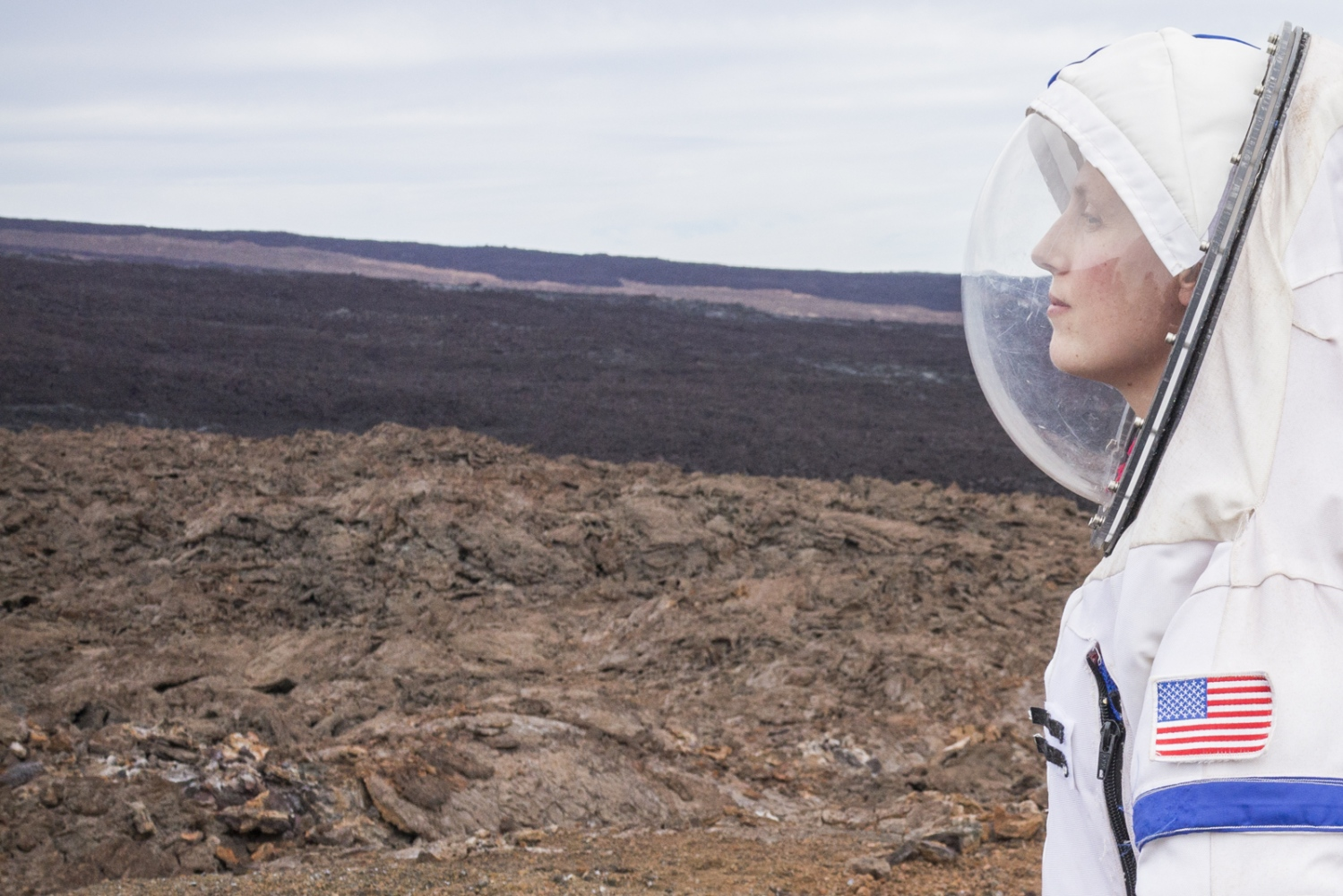 Martha Lenio, commander of the NASA human performance study Hawaii Space Exploration Analog and Simulation (HI-SEAS), is photographed wearing a spacesuit outside of the dome where she spent eight months of confinement together with other five researchers in the crater of the volcano Mauna Loa, Hawaii, Big Island.