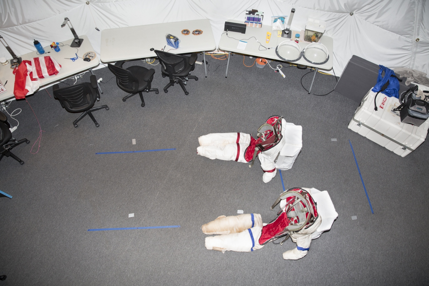 Space suits are photographed inside the dome on volcano Mauna Loa, where six researchers have been living for eight months in isolation for the NASA human performance study Hawaii Space Exploration Analog and Simulation. During the months of isolation the researchers can leave the dome only for brief excursions, wearing the spacesuits with a helmet and oxygen supply. Hawaii, Big Island.