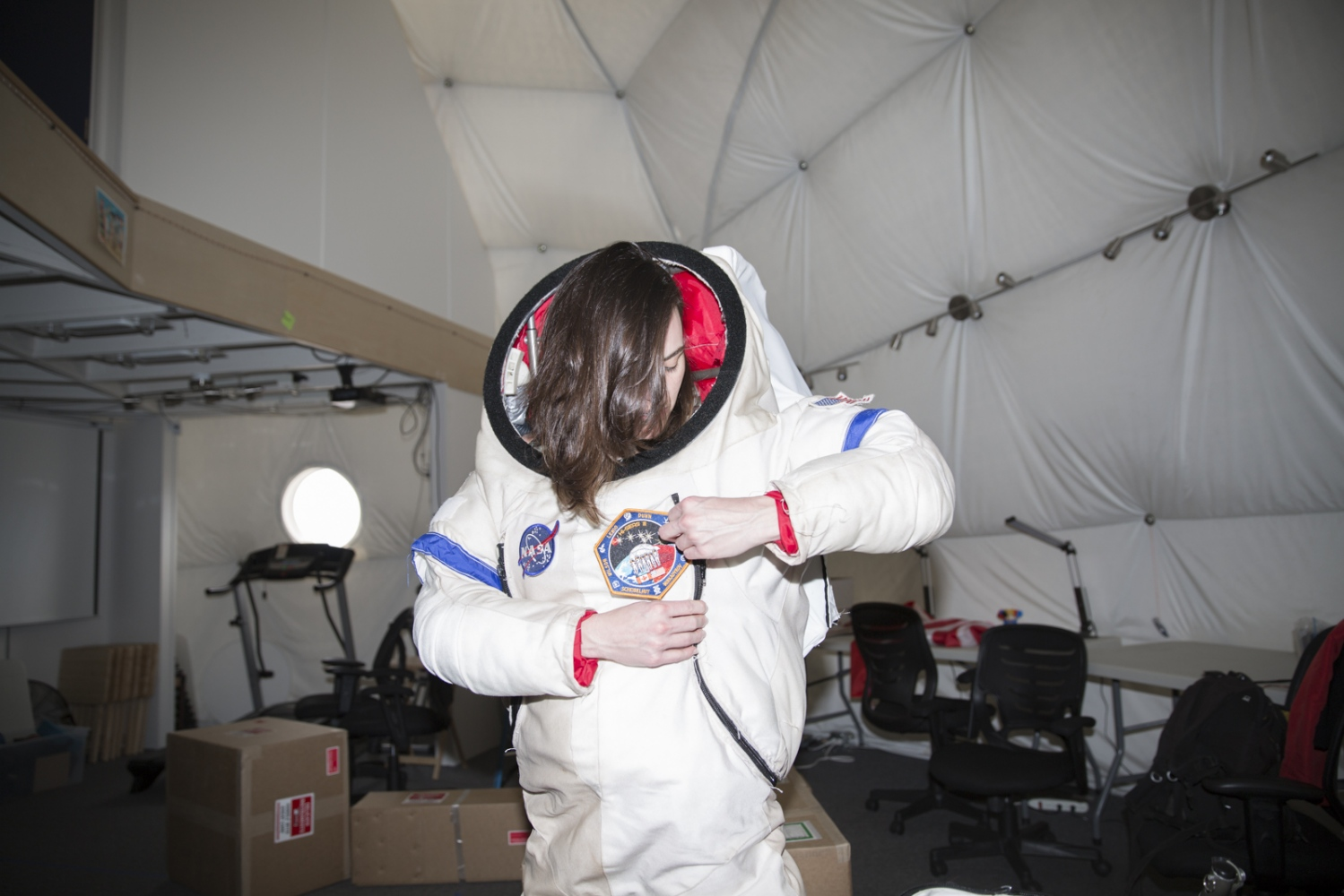 Jocelyn Dunn, crew of the NASA-financed human performance study called HI-SEAS, (Hawaii Space Exploration Analog and Simulation) adjusts her spacesuit for a walk outside of the dome where she spent eight months in confinement together with other five researchers in the crater of the volcano Mauna Loa, Hawaii, Big Island.