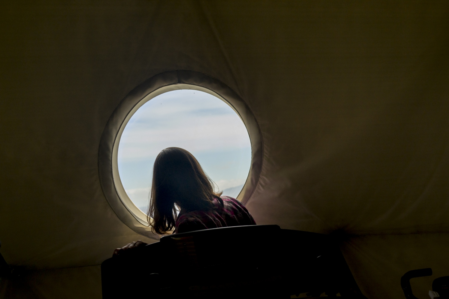 Researcher Jocelyn Dunn looks out of the dome where she's been living for eight months together with other other five researchers in the crater of the volcano Mauna Loa, Hawaii, Big Island.