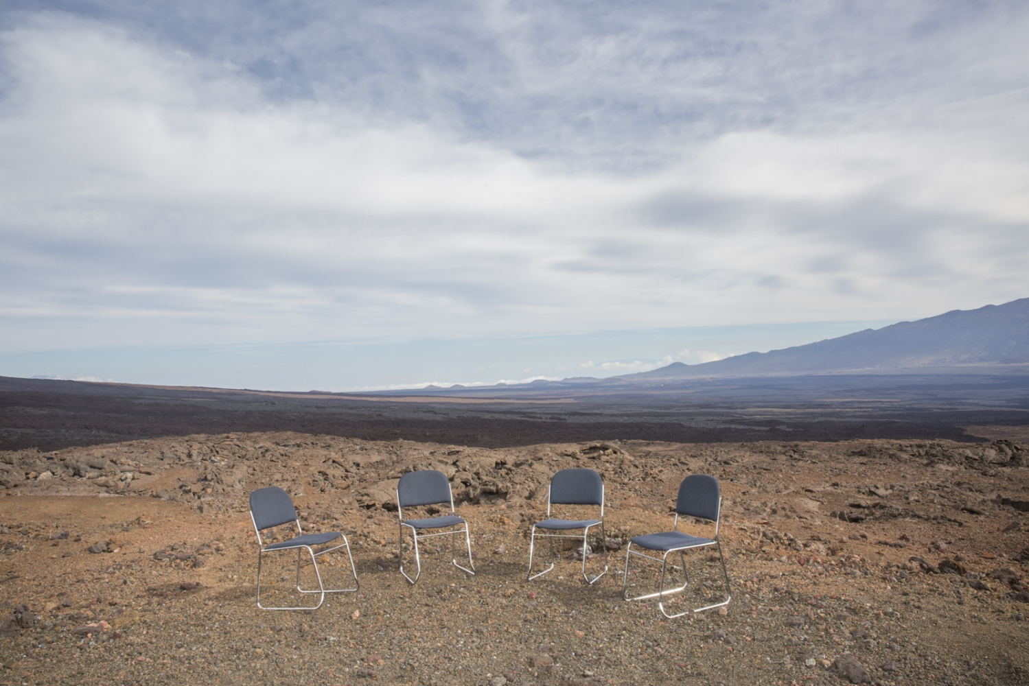 Chairs are photographed on volcano Mauna Loa on the day when six researchers who lived eight months of confinement in a dome came out of it for the end of the HI-SEAS (Hawaii Space Exploration Analog and Simulation) mission, whose purpose is to monitor the psychological response of human beings in condition of isolation in an unearthly environment, in perspective of the launch of scientific trips to Mars involving the presence of human beings of the planet.
