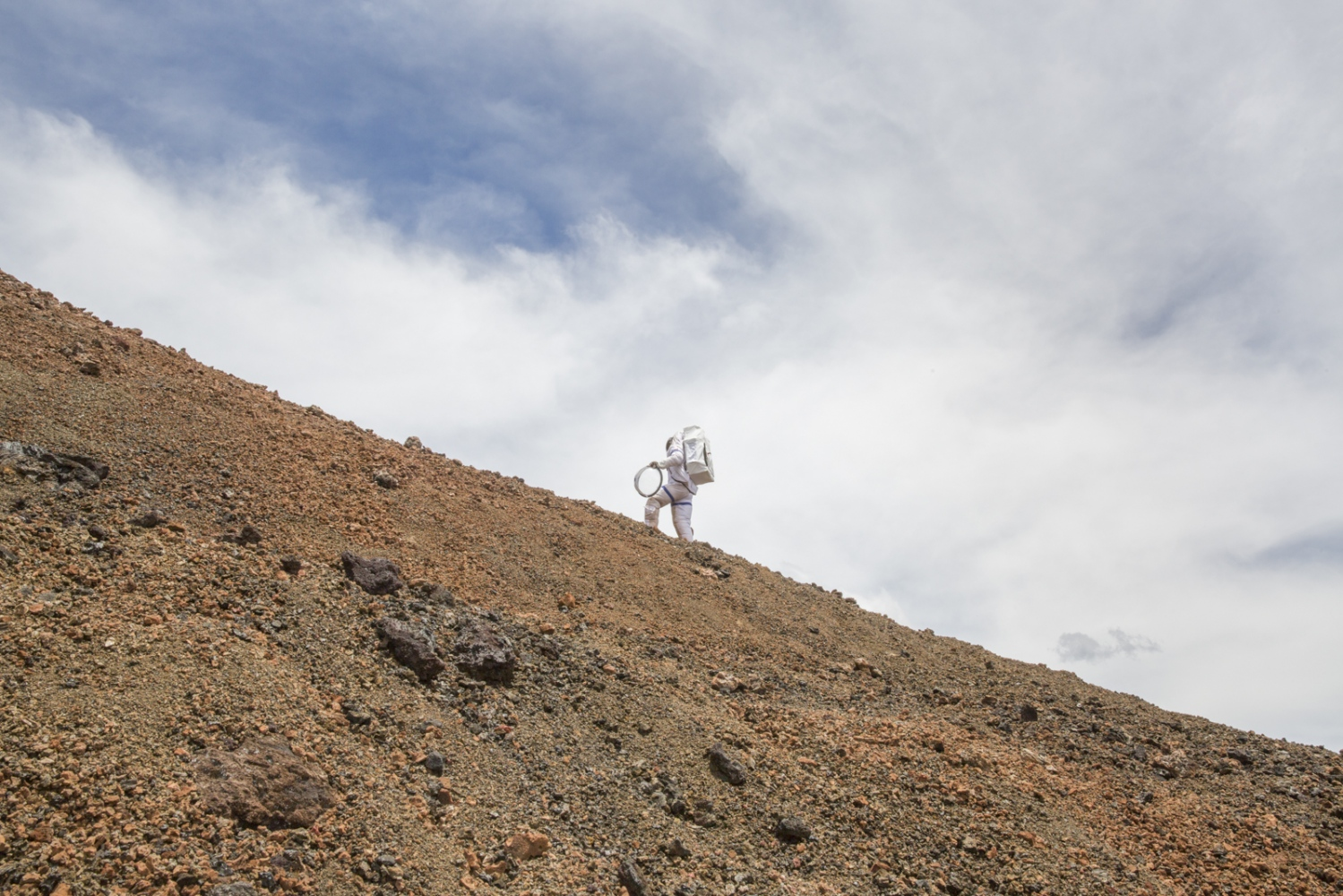 Researcher Jocelyn Dunn walks for the first time in a spacesuit but without a helmet after the end of a mission which saw her confined in a dome where she lived for eight months together with other other five researchers in the crater of the volcano Mauna Loa, Hawaii, Big Island.