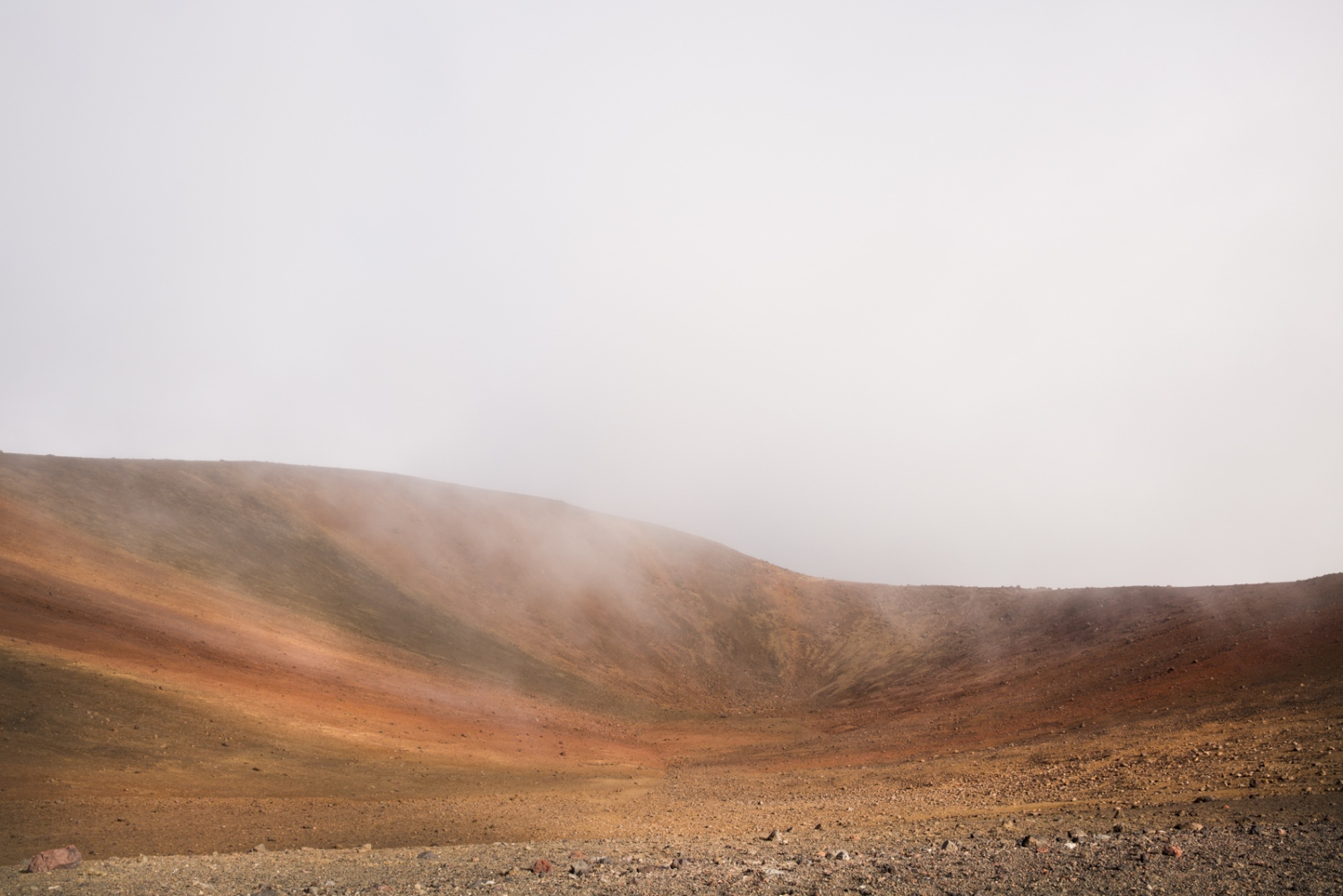 A landscape whose ground looks similar to the one that can be found on planet Mars is photographed on volcano Mauna Kea. Hawaii, Big Island.