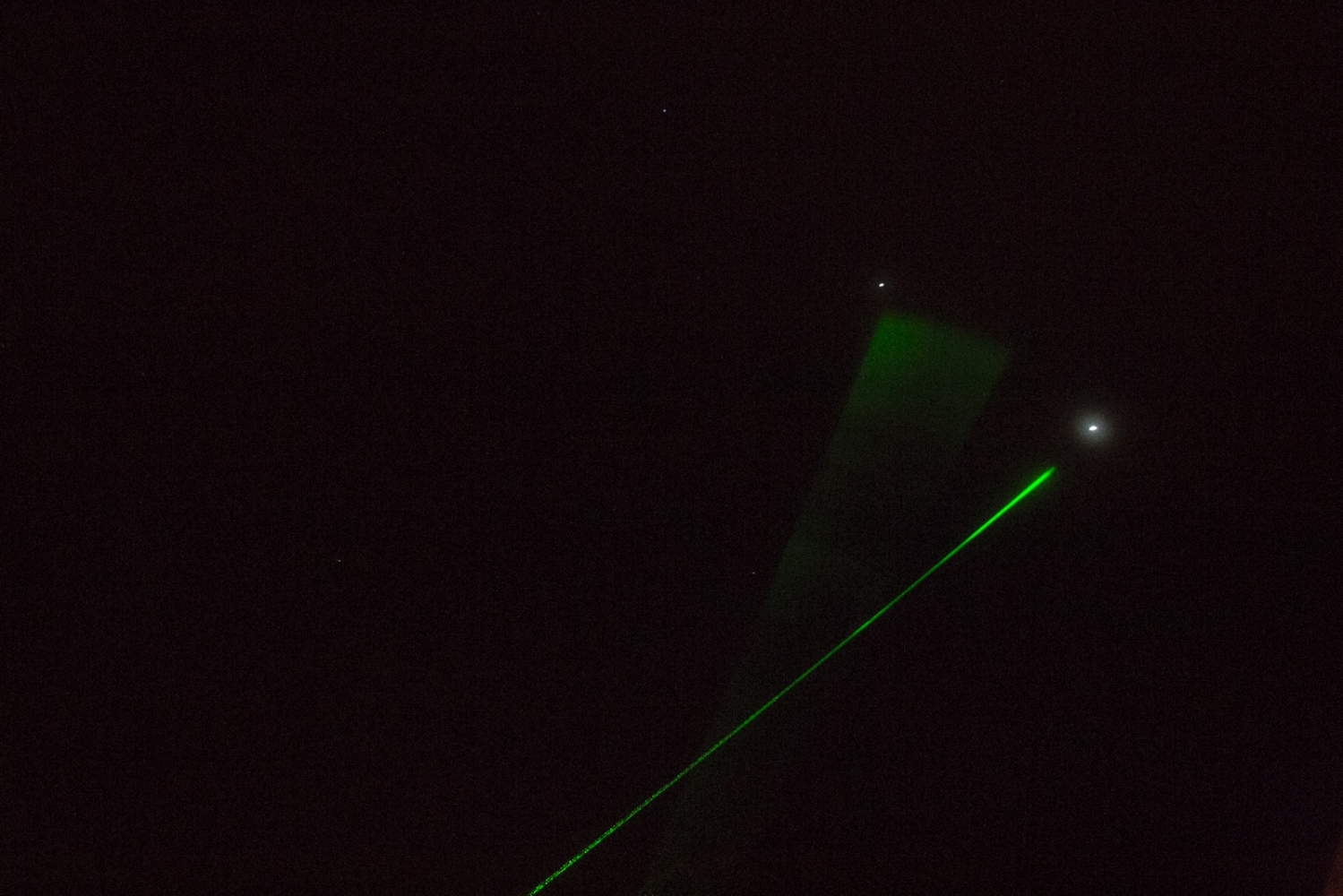 Guides from an observatory on volcano Mauna Kea use lasers to point at the stars and help visitors visualize them. Hawaii, Big Island.