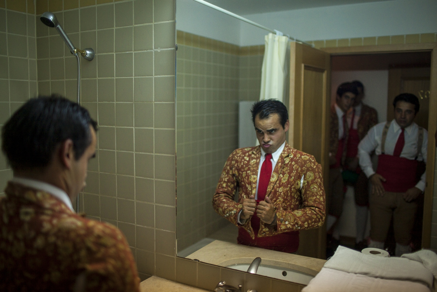 Ricardo Matxira gets ready for the bullfight in the hotel room.