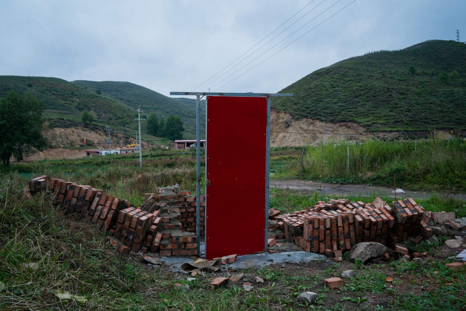 An abandoned housing construction in Taizicheng village. Soon after Beijing and Zhangjiakou won the bid for 2022 Winter Olympics, notices were put up in the village warning families to stop building more houses in an attempt to claim more compensation for future relocation.