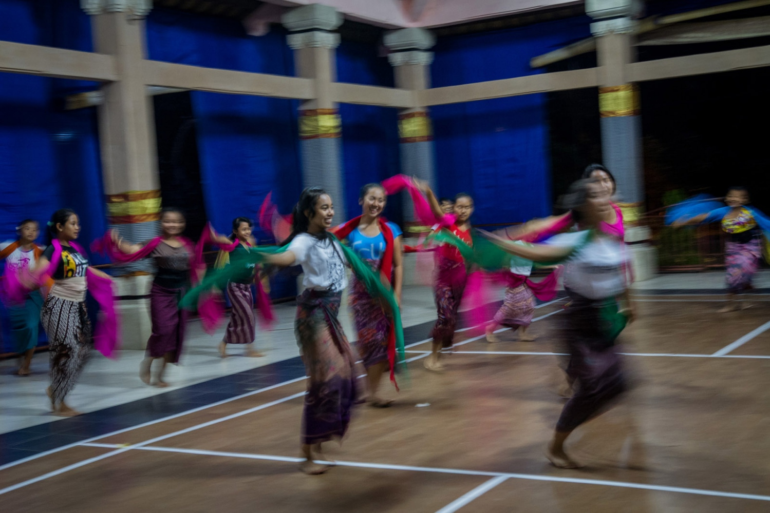Girls dance to Balinese gamalan music at a community center in Ubud, Bali, Indonesia, July 2015.