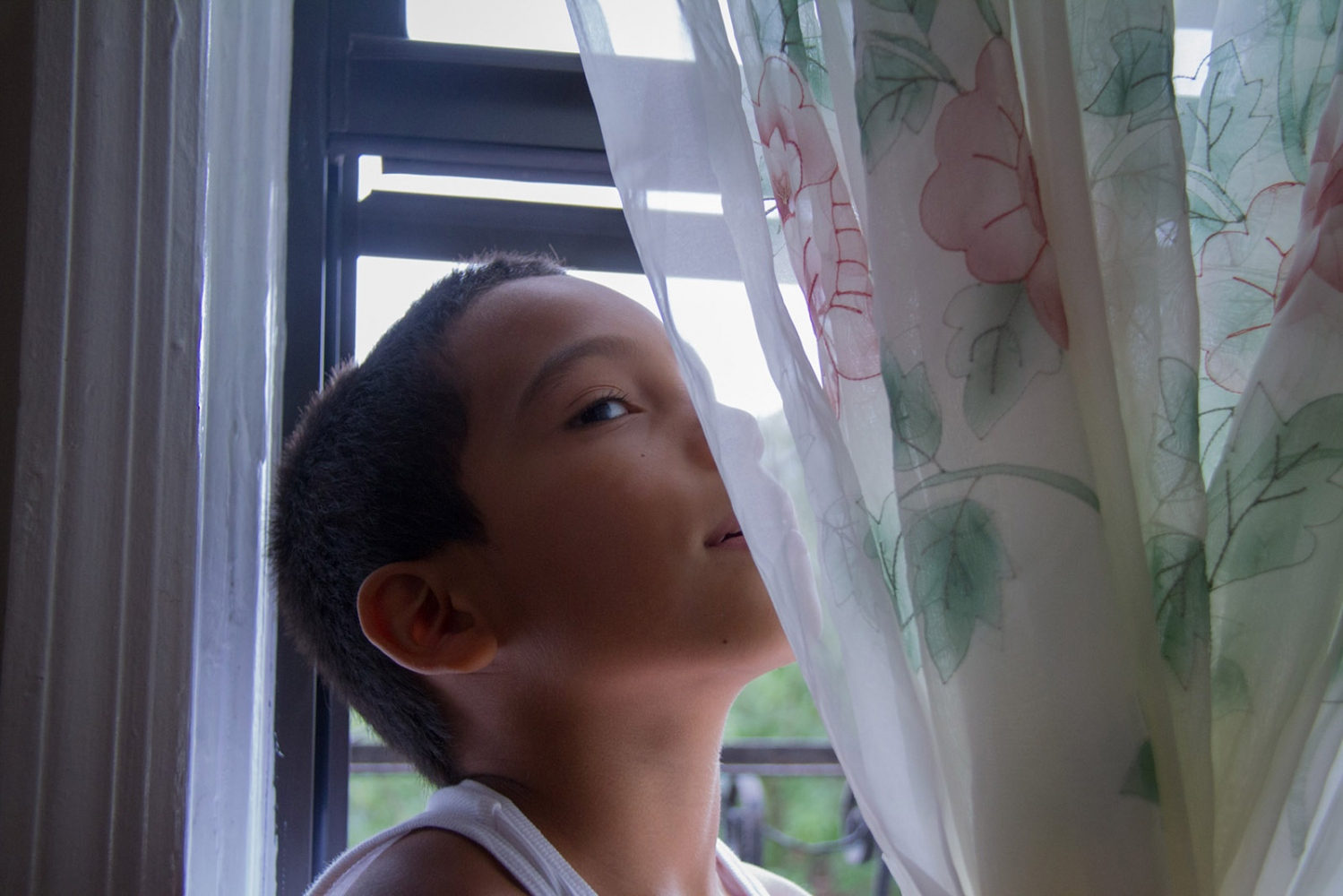 Little Alberto at his grandmother Carmen's home in Sunset Park, New York, August 2014.