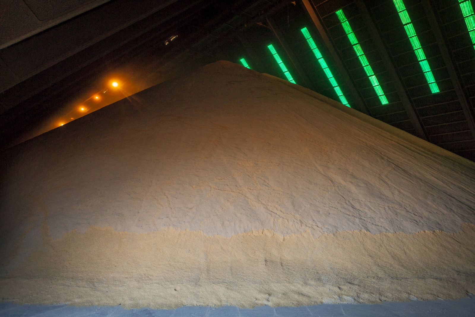 Soybeans are stored in cells before they are crushed at processing plant in Terminal 6 of the General San Martín Port, San Lorenzo. There are 15 cells and 15 silos in the port with a storage capacity of 1,6 million tons. On average per day 8 boats discharge their content in the port, corresponding to 14,000 tons. Terminal 6 is the largest of its kind in South America where 80,000 tons per day are received by trucks, trains and boats. The grains are then process at the plant located at the port and then shipped worldwide.